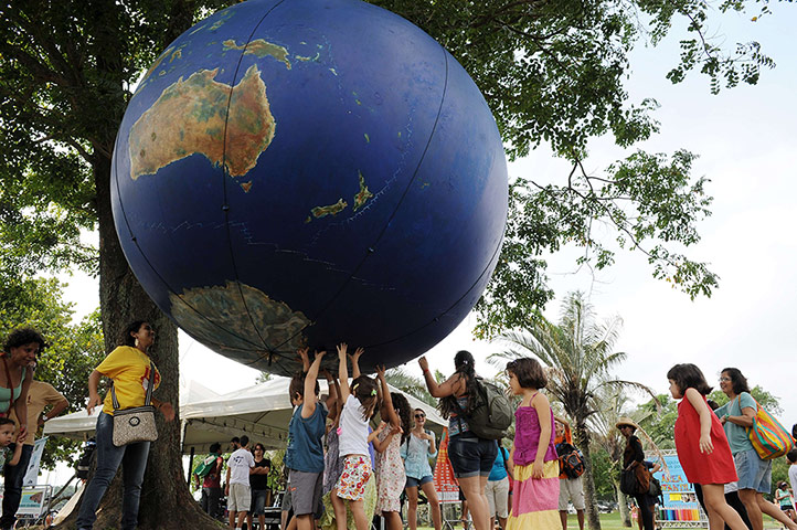 Children play with a giant globe at the People  s Summit in Flamengo park
